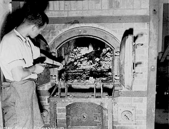 Human remains found in the Dachau concentration camp crematorium after liberation. Germany, April 1945. — US Holocaust Memorial Museum
