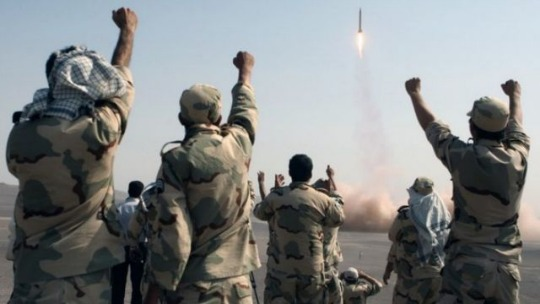 Members of the Iranian Revolutionary Guard watch a missile launch, July 2012 (Associated Press)